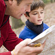 Father And Son Reading A Map Poster
