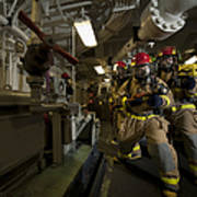 Firemen Combat A Simulated Fire Aboard Poster