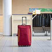 Luggage At An Airline Check-in Counter Poster by Jaak Nilson