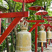 Row Of Bells In A Temple Covered By Red Umbrella Poster