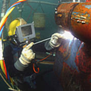 U.s. Navy Diver Welds A Repair Patch Poster