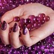 Woman Hand With Purple Nail Polish On Candy Poster