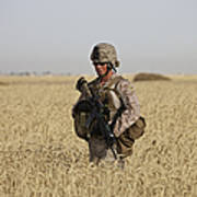 U.s. Marine Patrols A Wadi Near Kunduz Poster