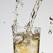 A Drink Being Poured Into A Glass Poster