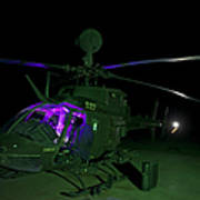An Oh-58d Kiowa Helicopter At Cob Poster