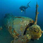 Diver Explores The Wreck Poster