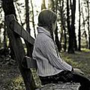 Girl Sitting On A Wooden Bench In The Forest Against The Light Poster
