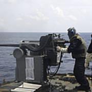 Gunner Fires A Mark 38 Machine Gun Poster
