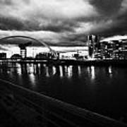 riverside walkway by the Clyde Arc bridge over the river clyde at dusk in Glasgow Scotland UK Poster