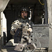A Uh-60 Black Hawk Door Gunner Manning Poster