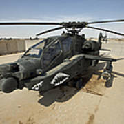 An Ah-64d Apache Helicopter At Cob Poster