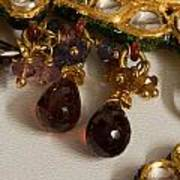 3 Hanging Semi-precious Stones Attached To A Green And Gold Necklace Poster