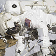 An Astronaut Participates In A Session Poster