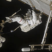 Astronaut Working On The International Poster