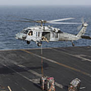 A Mh-60s Knighthawk Conducts A Vertical Poster