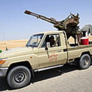 A Free Libyan Army Pickup Truck Poster by Andrew Chittock