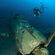 Diver Explores The Wreck Poster