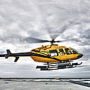 A Bell 407 Utility Helicopter Prepares Poster