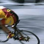 A Bicyclist Speeds Past In A Race Poster