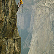 A Climber Makes His Way Up A Rock Face Poster