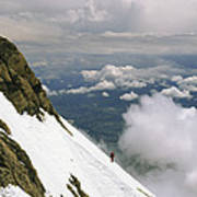 A Climber Walks Along A Steep Slope Poster