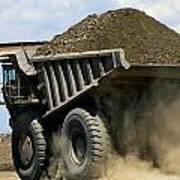 A Dump Truck Carrying Gravel Kicks Poster