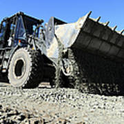 A Front End Loader Raising A Road Bed Poster