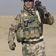 A German Soldier Carries A Barrett Poster