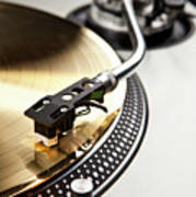 A Gold Record On A Turntable Poster by Caspar Benson