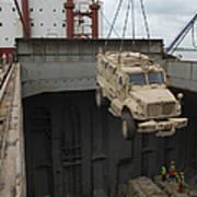 A Harbor Crane Lifts A Mine-resistant Poster