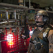 A Loadmaster Waits To Release A Load Poster