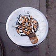 A Lot Of Cigarettes Stubbed Out At A Garbage Bin Poster