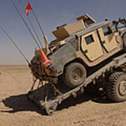 A M1114 Armored Vehicle Is Unloaded Poster