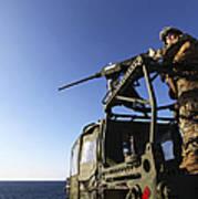 A Machine Gunner Mounts A M-2 Poster by Stocktrek Images