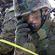 A Marine Communicates Over The Radio Poster