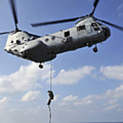 A Marine Fast Ropes From A Ch-46e Sea Poster