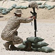 A Marine Hangs Dog Tags On The Rifle Poster