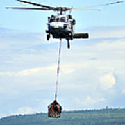 A Mh-60 Knighthawk Carries Supplies Poster