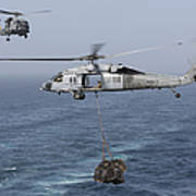 A Mh-60s Knighthawk Transfers Cargo Poster