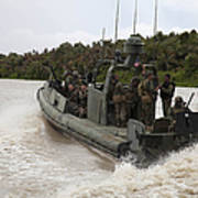 A Navy Riverine Patrol Boat Conducts Poster