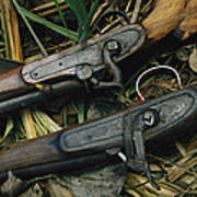 A Pair Of Old Flint-type Rifles Lying Poster