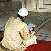 A Pious Devotee Reading The Quran Inside The Jama Masjid In Delhi Poster