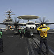 A Plane Director Guides An E-2c Hawkeye Poster