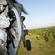 A Platoon Sergeant Prepares To Land Poster