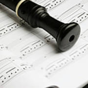 A Recorder Lying On A Book Of Sheet Music Poster by Studio Blond