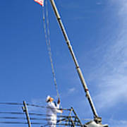 A Sailor Lowers The U.s. Navy Jack Poster