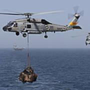 A Sh-60j Seahawk Transfers Cargo Poster