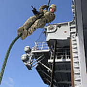 A Soldier Fast-ropes From The Rear Poster by Stocktrek Images