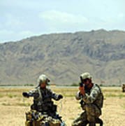 A Soldier Prepares A Drag Line While An Poster