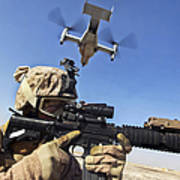 A Soldier Provides Security As An Mv-22 Poster